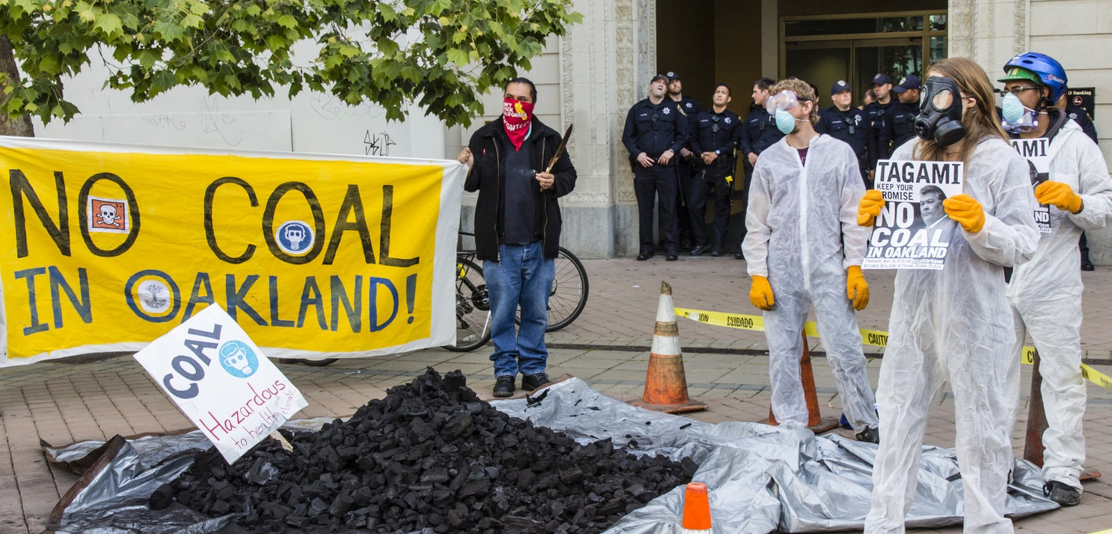Demonstrators dump coal in front of developer Phil Tagami's office.
