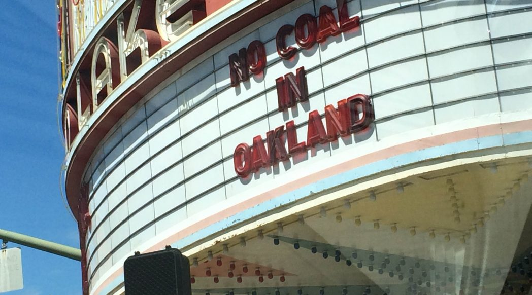 "Oakland's Grand Lake Theatre marquee advocating ""No Coal in Oakland."" Photo credit: Toni Morozumi."
