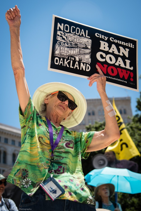 Demonstrator holding a Ban Coal Now sign Photo: Brooke Anderson