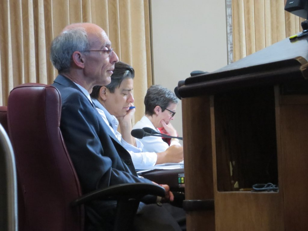 Oakland City Council members Dan Kalb and Rachel Kaplan, and Assistant City Administrator Claudia Cappio, listen to testimony at the City Council meeting, 2016-06-27. Photo credit: Steve Masover.