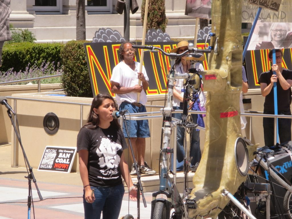 Desirae Harp opening the rally with Native American songs and her own music, at NCIO rally, 2016-06-25. Photo: Steve Masover