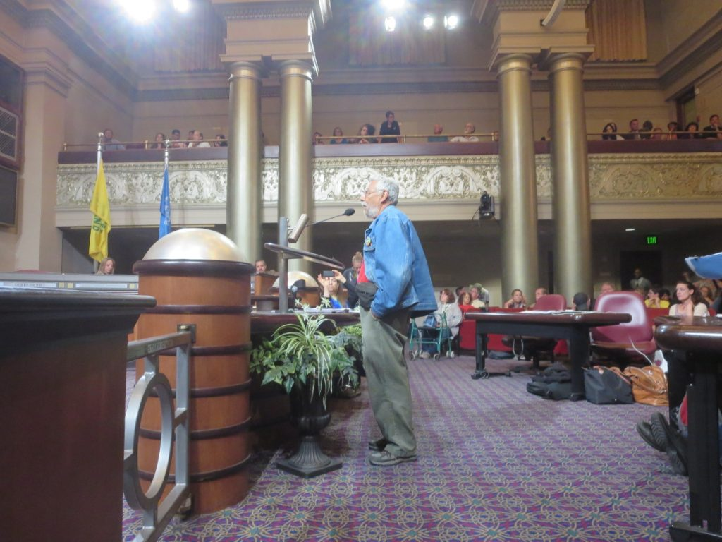 Poet and elder of the Xochipilli Latino Men's Circle, Rafael Jesus Gonzales, addresses the Oakland City Council, 2016-06-27. Photo credit: Steve Masover.