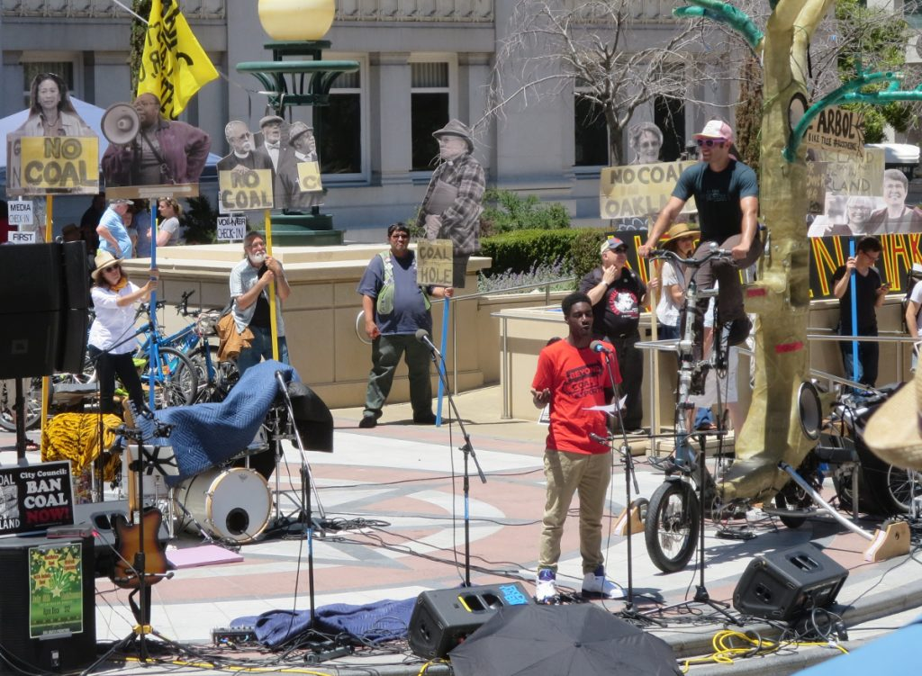 Nate Henderson, Oakland High School student and a fellow with the New Voices Are Rising Project of the Rose Foundation for Communities and the Environment, voicing a West Oakland community perspective, at NCIO rally, 2016-06-25. Photo: Steve Masover