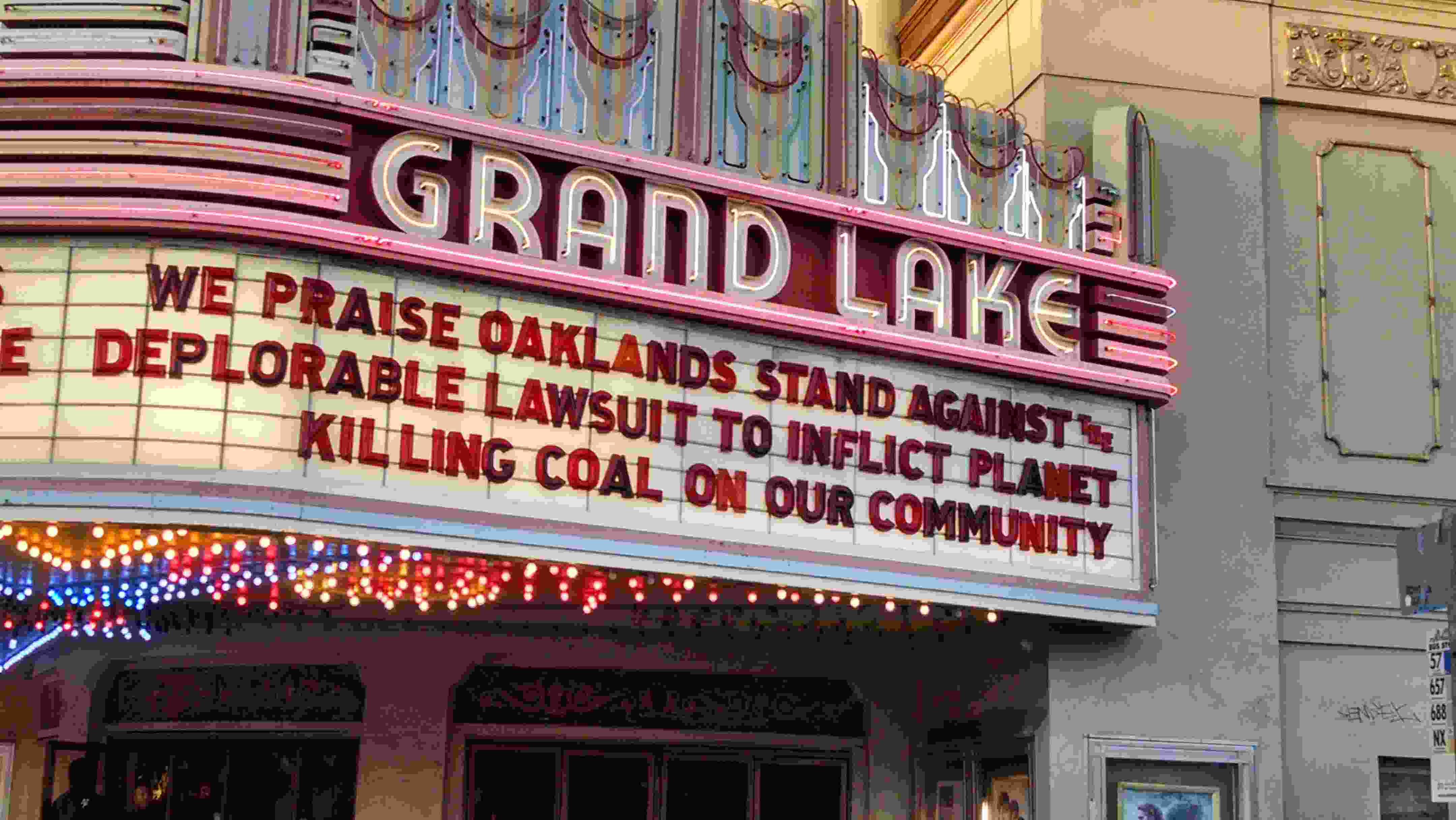 Grand Lake Theater marquee deploring Tagami's lawsuit against the City of Oakland