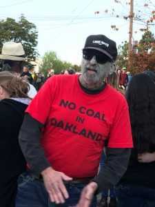 A zombie spotted near Phil Tagami's house on October 30, 2017, wearing a No Coal in Oakland t-shirt. Photo credit: Kim White.