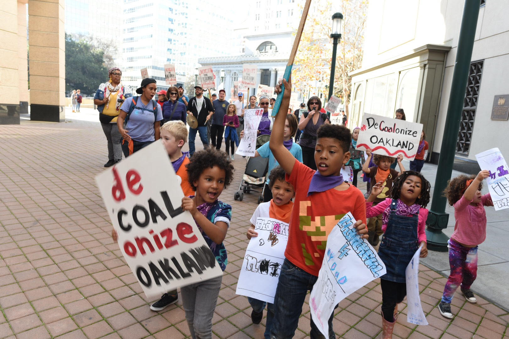 Youth march around Phil Tagami's Rotunda Building demanding the coal developer #DeCOALonize Oakland. Photo credit: Sunshine Velasco from Survival Media Agency