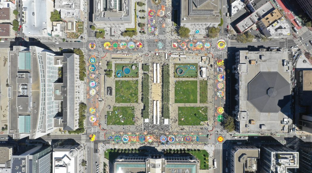 Civic Center street mural, aerial view, Rise for Climate, Jobs and Justice, 2018-09-08. Photo credit: 350.org (CC BY-NC-SA 2.0).