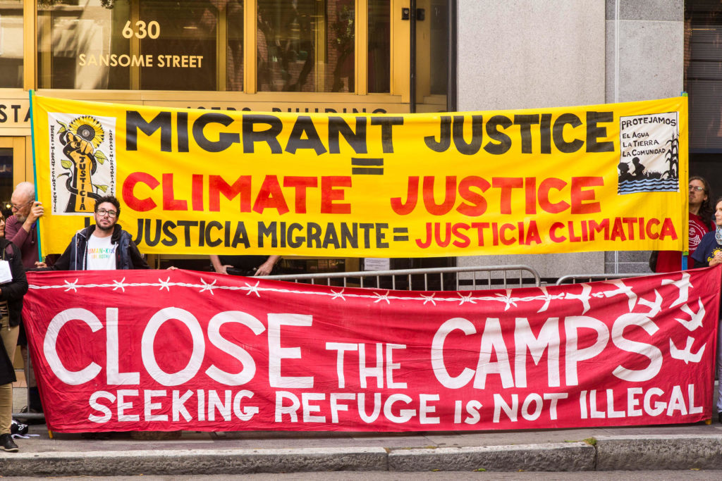 Migrant Justice Is Climate Justice - August 5, 2019 - Banners by David Solnit et al. - photo by Steve Nadel